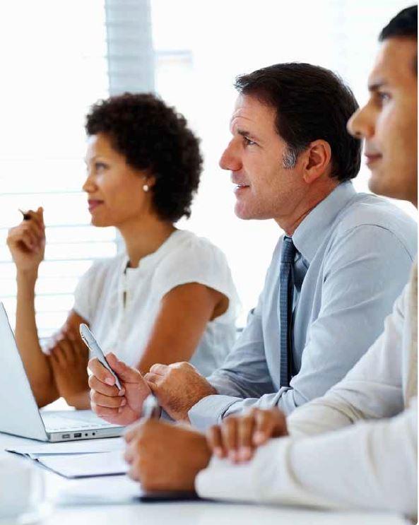 three people in a board meeting